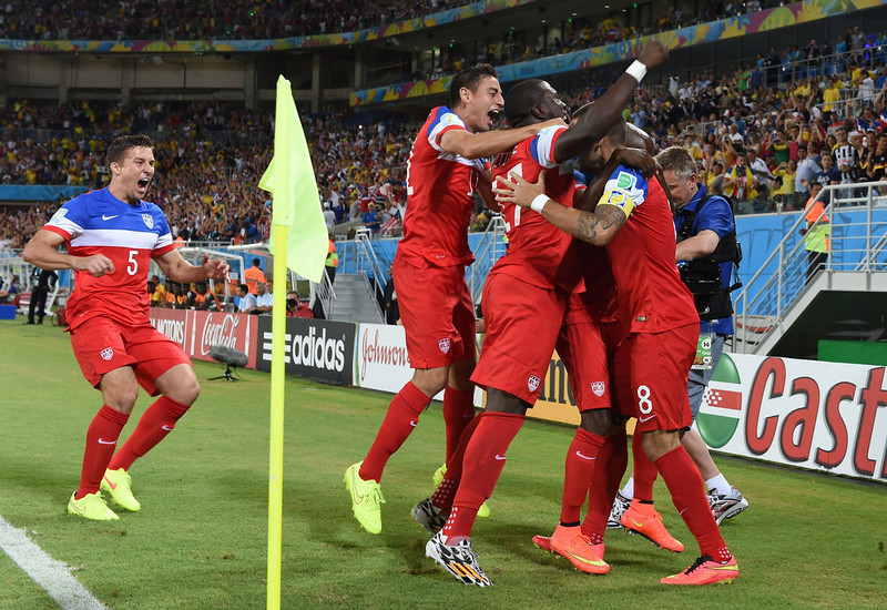 . US forward Clint Dempsey (R) celebrates with teammates after scoring during a Group G football match between Ghana and US at the Dunas Arena in Natal during the 2014 FIFA World Cup on June 16, 2014.   CARL DE SOUZA/AFP/Getty Images