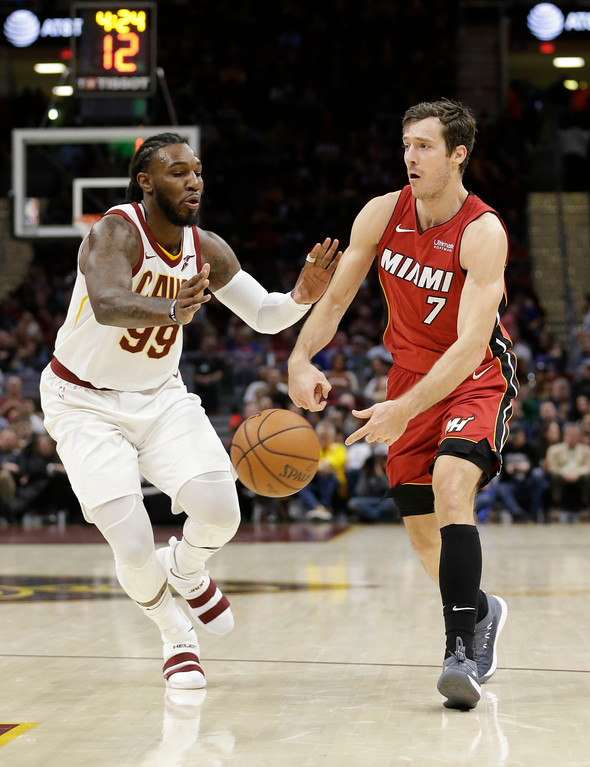 . Miami Heat\'s Goran Dragic (7), from Slovenia, passes against Cleveland Cavaliers\' Jae Crowder (99) in the second half of an NBA basketball game, Tuesday, Nov. 28, 2017, in Cleveland. The Cavaliers won 108-97. (AP Photo/Tony Dejak)