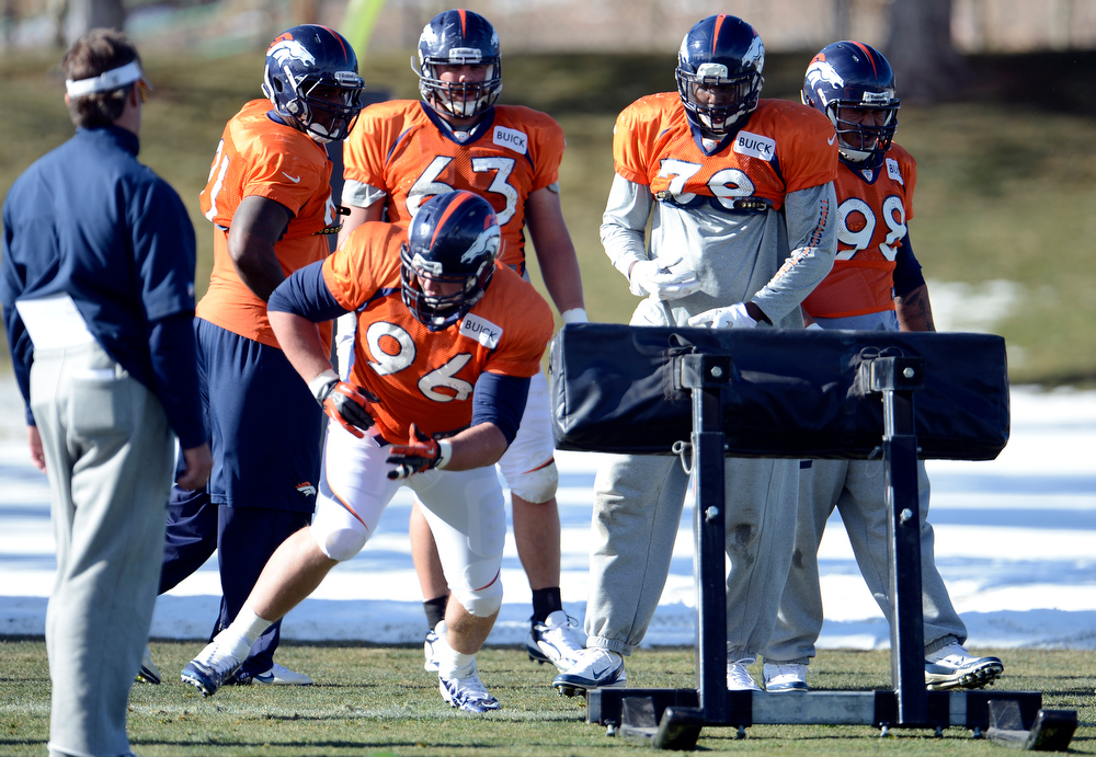 . Denver Broncos defensive tackle Mitch Unrein (96) hits the sled during  practice Wednesday, December 12,  2012 at Dove Valley.  John Leyba, The Denver Post