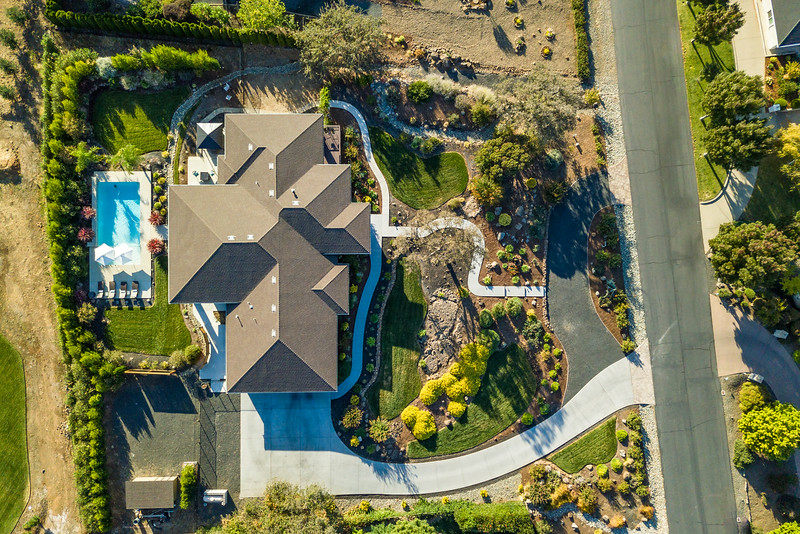 Birdseye-view-of home-with-beautiful-landscaping.jpg