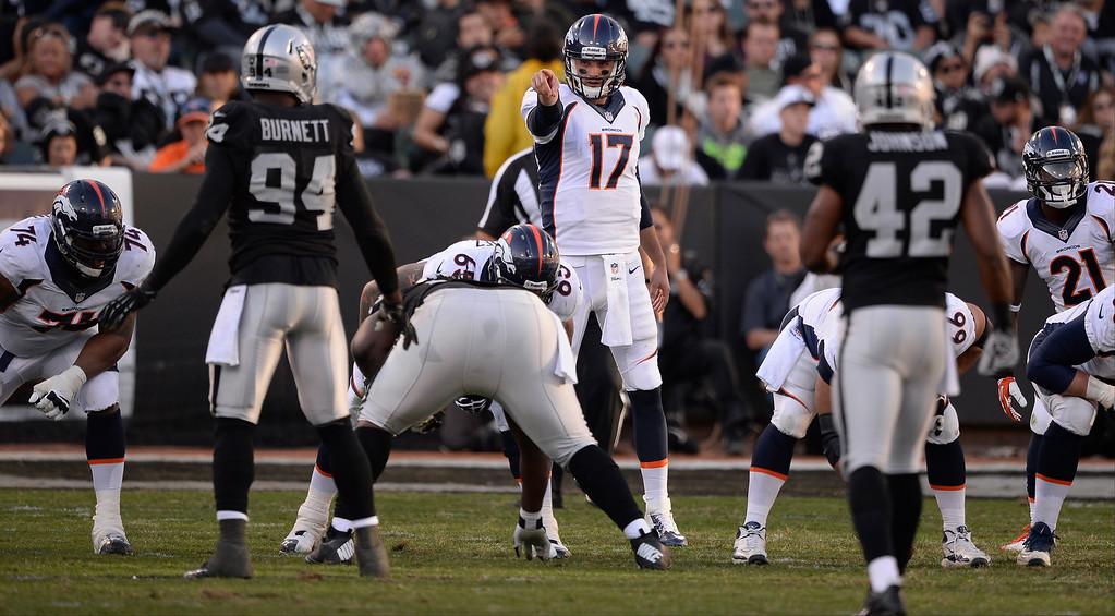. Denver Broncos quarterback Brock Osweiler (17) points out the Oakland Raiders defense during the third quarter at O.co Coliseum. (Photo by John Leyba/The Denver Post)