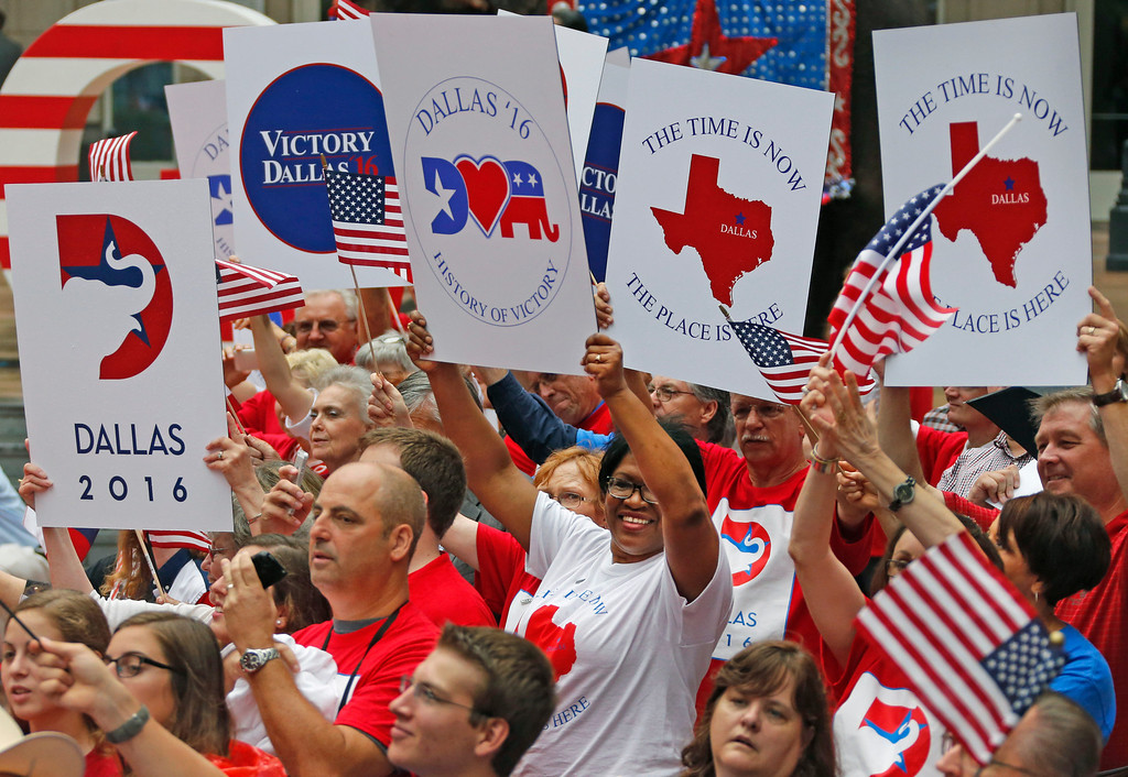 . Supporters cheer as the Republican National Committee site selection committee arrives along a red carpet laid through the plaza outside the American Airlines Center, as they are courted by the city for the 2016 national convention, on Thursday, June 12, 2014.  (Louis DeLuca/Dallas Morning News)
