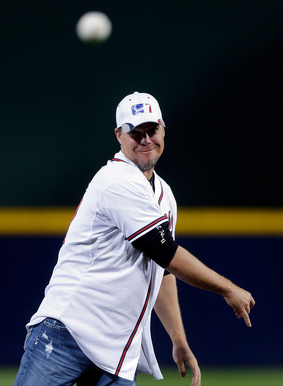 . Former Atlanta Braves player Chipper Jones throws out the ceremonial first pitch before Game 1 of the National League Divisional Series against the Los Angeles Dodgers, Thursday, Oct. 3, 2013, in Atlanta. (AP Photo/David Goldman)