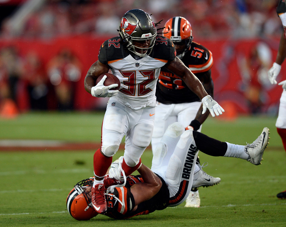 . Tampa Bay Buccaneers running back Jacquizz Rodgers is hit by Cleveland Browns outside linebacker Joe Schobert (53) during the first quarter of an NFL preseason football game Saturday, Aug. 26, 2017, in Tampa, Fla. (AP Photo/Jason Behnken)