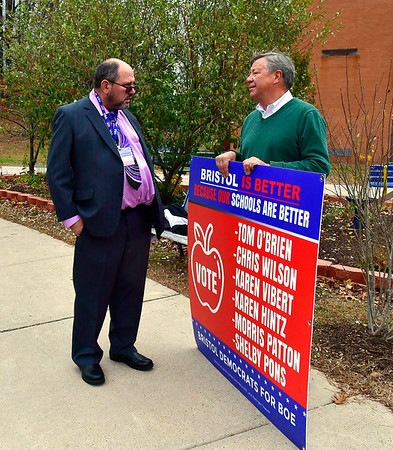 11/5/2019 Mike Orazzi | StaffrTerry Parker talks with Dave Preleski while at the South Side School on election day in Bristol.