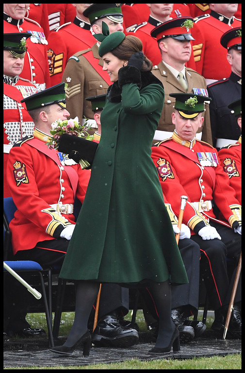 . Britain\'s Kate, the Duchess of Cambridge, walks as she and Prince William visit the 1st Battalion Irish Guards, for the St. Patrick\'s Day Parade, at Cavalry Barracks, in Hounslow, England, Saturday, March 17, 2018.  (Andrew Parsons/Pool Photo via AP)