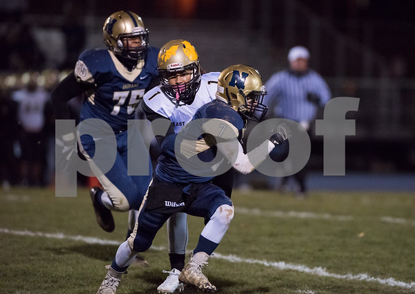 11/09/17 Wesley Bunnell | Staff Newington football hosted East Hartford on Friday night. Brendan Connor (7).