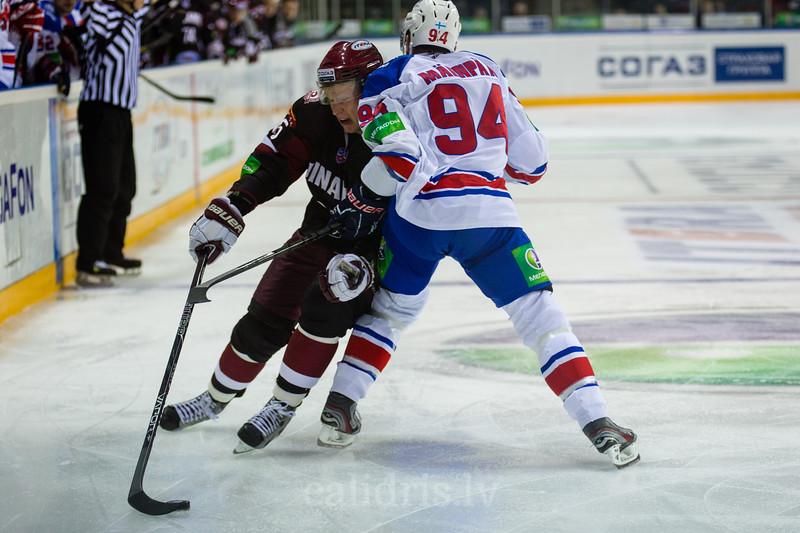 Mikko Maenpaa (94) tries to stop Andris Dzerins (25)