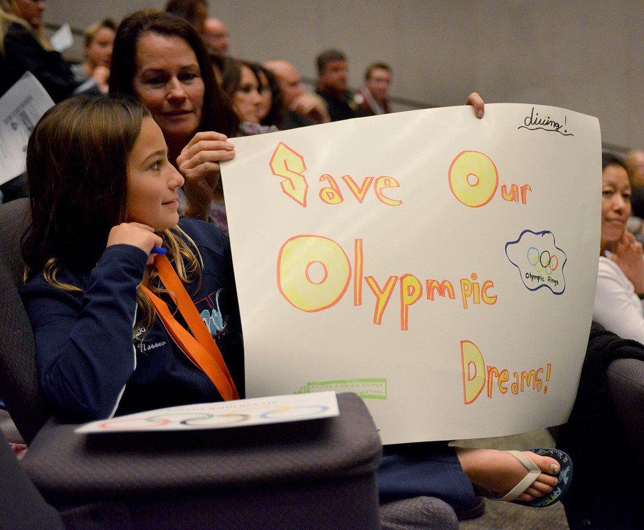 . 2-12-2013--(LANG Staff Photo by Sean Hiller)-Elaine Nasser,9, who dives at McCormick\'s and her mother Mary Ann attend Tuesday\'s Long Beach City Council meeting to participate in the discussion to build a temporary Belmont Pool in advance of building a replacement for the old pool, which has been deemed seismically unsafe.