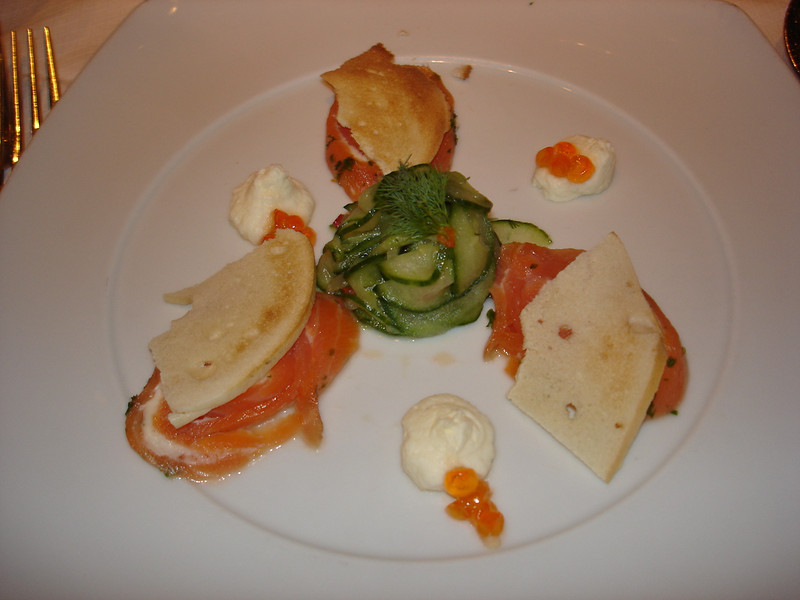 Salmon with cream cheese, cucumber, salmon caviar, and bagel chips