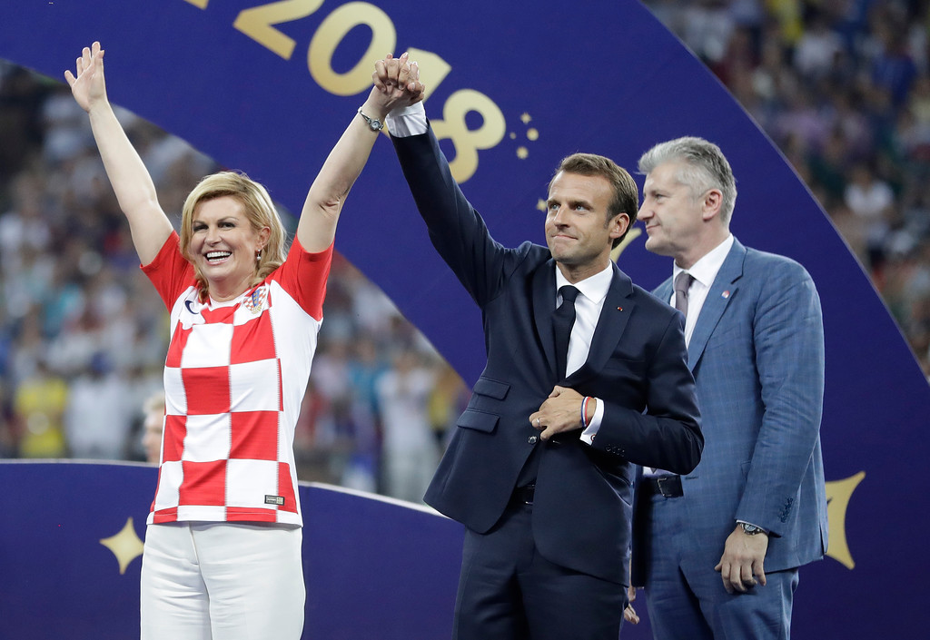 . French President Emmanuel Macron and Croatian President Kolinda Grabar-Kitarovic arrive for the presentation after the final match between France and Croatia at the 2018 soccer World Cup in the Luzhniki Stadium in Moscow, Russia, Sunday, July 15, 2018. France won the final 4-2. (AP Photo/Matthias Schrader)