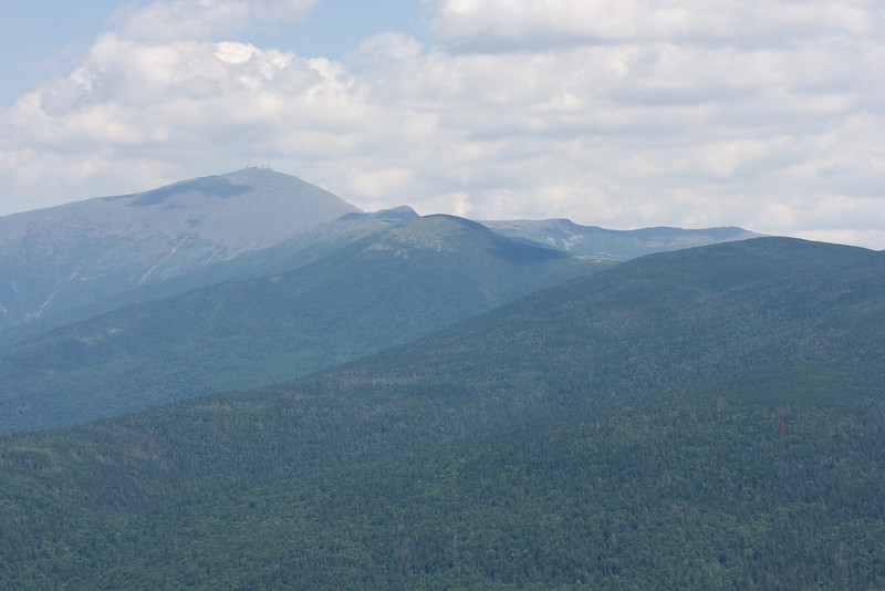 Mt. Washington, Mt. Monroe, Mt. Eisenhower, and Mt. Pierce.  Crawford Path climbs the closer ridge, Edmunds Path the farther ridge (Mt. Eisenhower).  Behind is Boott Spur.