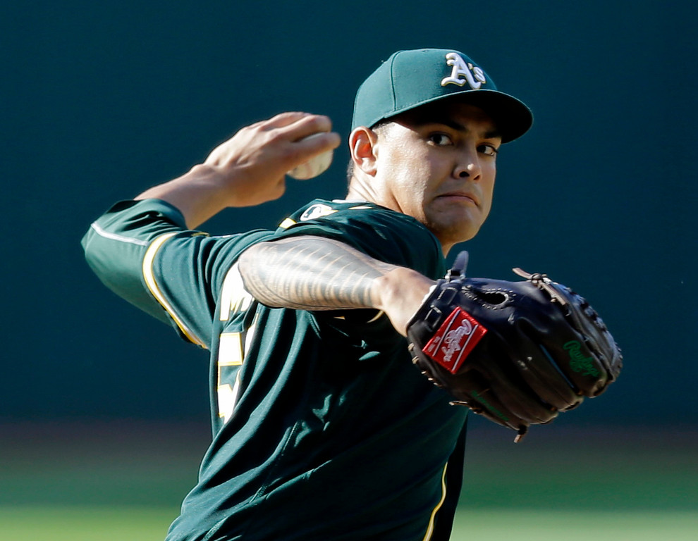. Oakland Athletics starting pitcher Sean Manaea delivers in the first inning of a baseball game against the Cleveland Indians, Wednesday, May 31, 2017, in Cleveland. (AP Photo/Tony Dejak)