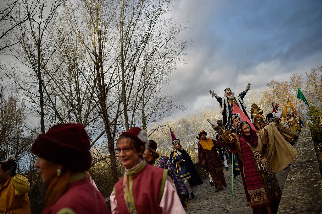 . The Cabalgata Los Reyes Magos (Cavalcade of the three kings) crosses the Magdalena bridge the day before Epiphany, in Pamplona, northern Spain, Tuesday, Jan. 5, 2016. It is a parade symbolizing the coming of the Magi to Bethlehem following the birth of Jesus. In Spain and many Latin American countries Epiphany is the day when gifts are exchanged. (AP Photo/Alvaro Barrientos)