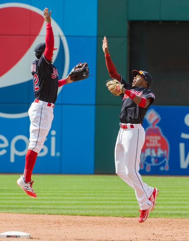 . Cleveland Indians\' Greg Allen, right celebrates with Francisco Lindor after beating the Minnesota Twins, 5-3, at a baseball game in Cleveland, Thursday, Aug. 30, 2018. (AP Photo/Phil Long)