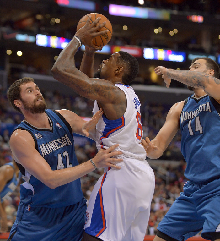 . Los Angeles Clippers\' DeAndre Jordan battles under the hoop wth Kevin Love of the Minnesota Timberwolves\' in the first half Monday, Nov. 11, 2013, in Los Angeles.(Andy Holzman/Los Angeles Daily News)