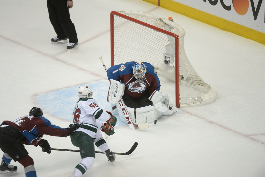 . Semyon Varlamov (1) of the Colorado Avalanche makes saves a shot on goal by Erik Haula (56) of the Minnesota Wild in front of Tyson Barrie (4) of the Colorado Avalanche during the first period of action.  (Photo by Karl Gehring/The Denver Post)