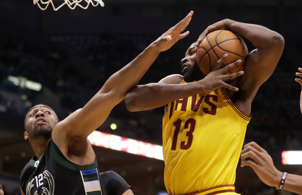 . Cleveland Cavaliers\' Tristan Thompson rebounds in front of Milwaukee Bucks\' Jabari Parker during the first half of an NBA basketball game Tuesday, Dec. 20, 2016, in Milwaukee. (AP Photo/Morry Gash)