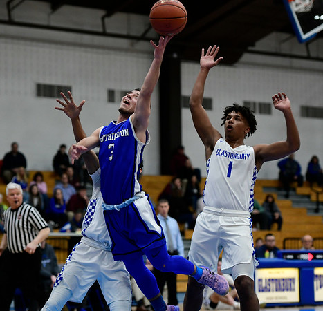 3/6/2019 Mike Orazzi | Staff Southington's Jared Kelly (10) and Glastonbury's Freddie Thomas (1) during Wednesday night's Division II Second Round State Boys Basketball Tournament with at Glastonbury High School.