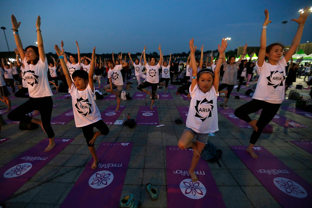 . Children perform yoga to mark the International Day of Yoga in Seoul, South Korea, Wednesday, June 21, 2017. Millions of yoga enthusiasts bent and twisted their bodies in complex postures across much of the world on Wednesday to mark the third International Yoga Day. (AP Photo/Ahn Young-joon)