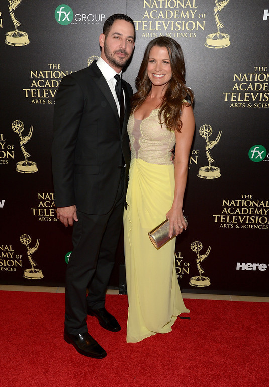 . Actress Melissa Claire Egan (R) and Matt Katrosar attend The 41st Annual Daytime Emmy Awards at The Beverly Hilton Hotel on June 22, 2014 in Beverly Hills, California.  (Photo by Jason Kempin/Getty Images)