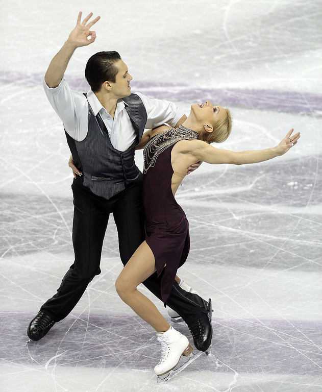 . Tatiana Volosozhar and Maxim Trankov of Russia skate in their short program in the pairs competition at the 2013 World Figure Skating Championships in London, Ontario, March 13, 2013.   GEOFF ROBINS/AFP/Getty Images