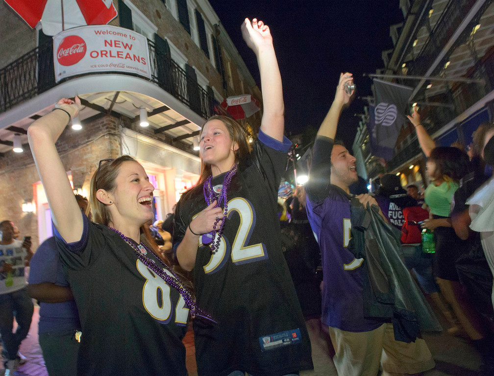 . Baltimore Ravens fans celebrate the team\'s victory as fans from the Ravens and San Francisco 49ers NFL football teams pack the French Quarter on Bourbon Street for Super Bowl XLVII in New Orleans, Sunday, Feb. 3, 2013. (AP Photo/Matthew Hinton)