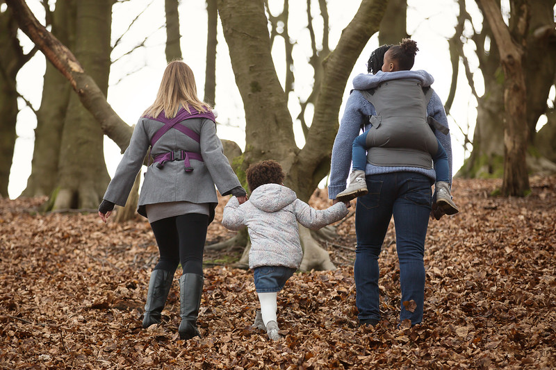 Izmi_Toddler_Carrier_Cotton_Mid_Grey_Lifestyle_Back_Carry_Family_Holding_Hands.jpg