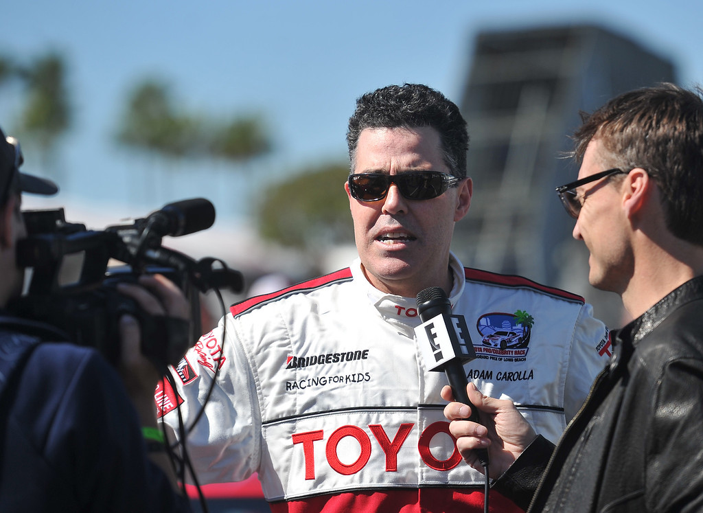 . 4/9/13 - Adam Carolla gives an interview during media day for the 39th Annual Toyota Grand Prix of Long Beach. The celebrity/pro races spent the day practicing on the track, joking with their racing partners and giving interviews. Photo by Brittany Murray / Staff Photographer
