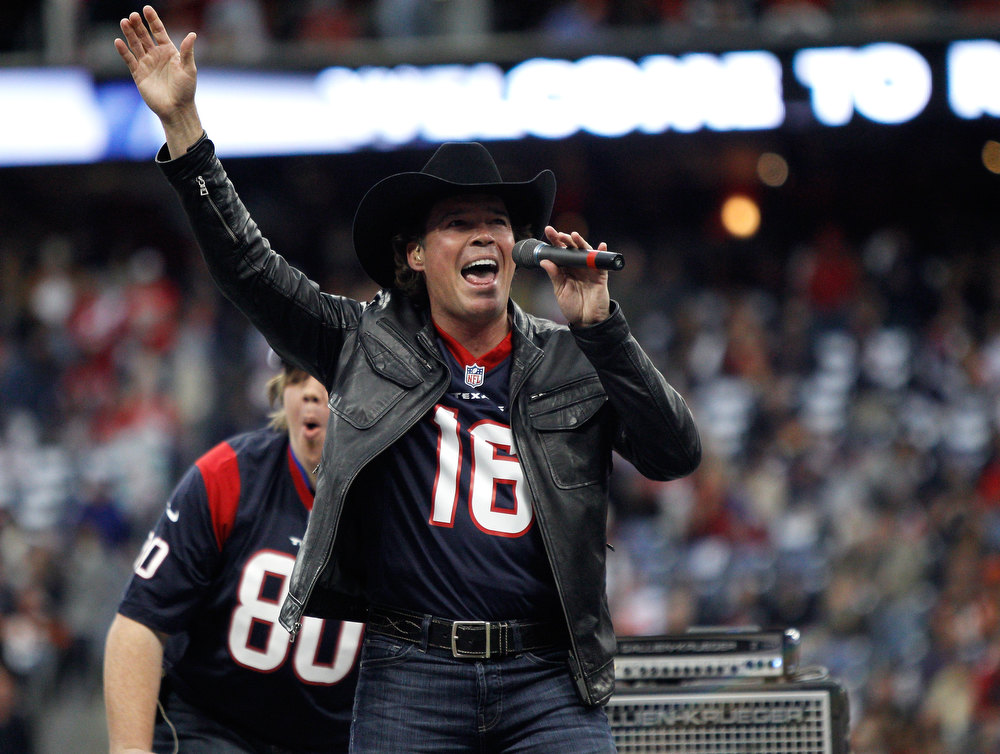 . Country Singer Clay Walker performs as the Houston Texans host the Cincinnati Bengals during their AFC Wild Card Playoff Game at Reliant Stadium on January 5, 2013 in Houston, Texas.  (Photo by Bob Levey/Getty Images)