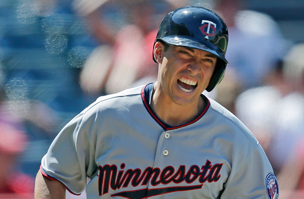 . Minnesota\'s Doug Bernier reacts after he was hit by a pitch by Angels closer Ernesto Frieri during the ninth inning. (AP Photo/Jae C. Hong)