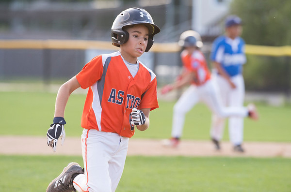 08/29/19 Wesley Bunnell | Staff The McCabe-Waters Astros vs the Forrestville Dodgers 3-0 at Breen Field on in the final game on Thursday night at Breen Field for the City Series championship. Mason Allen (6) rounds third base on his way to score.