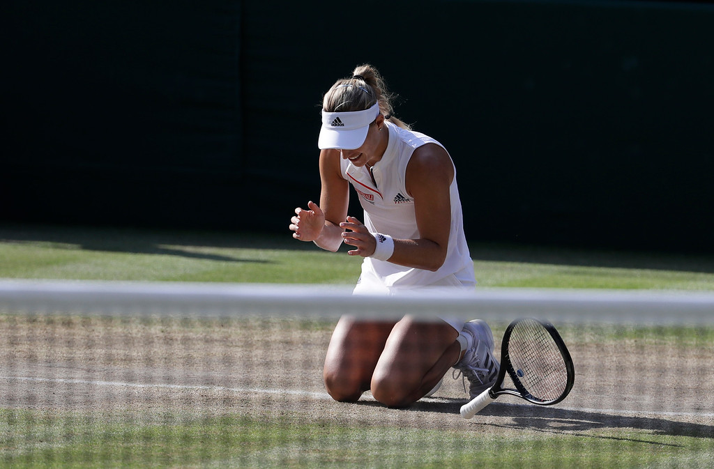 . Germany\'s Angelique Kerber celebrates winning the women\'s singles final match against Serena Williams of the United States, at the Wimbledon Tennis Championships, in London, Saturday July 14, 2018.(AP Photo/Ben Curtis)
