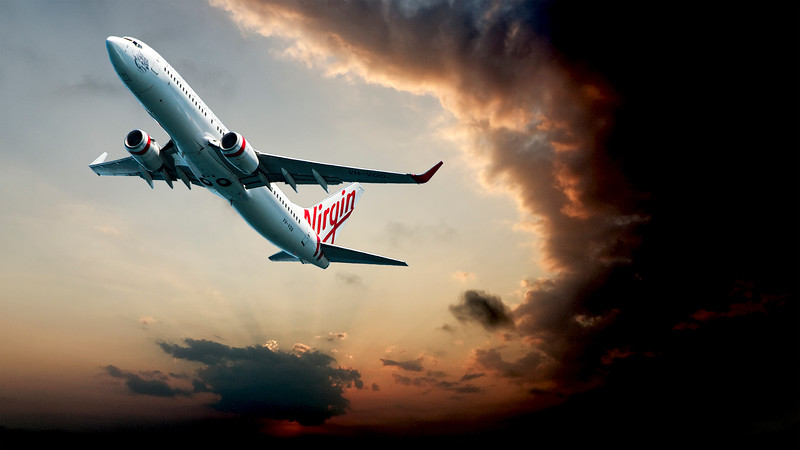 Passenger Jet Aircraft take off through storm cloud. Sydney. Australia.