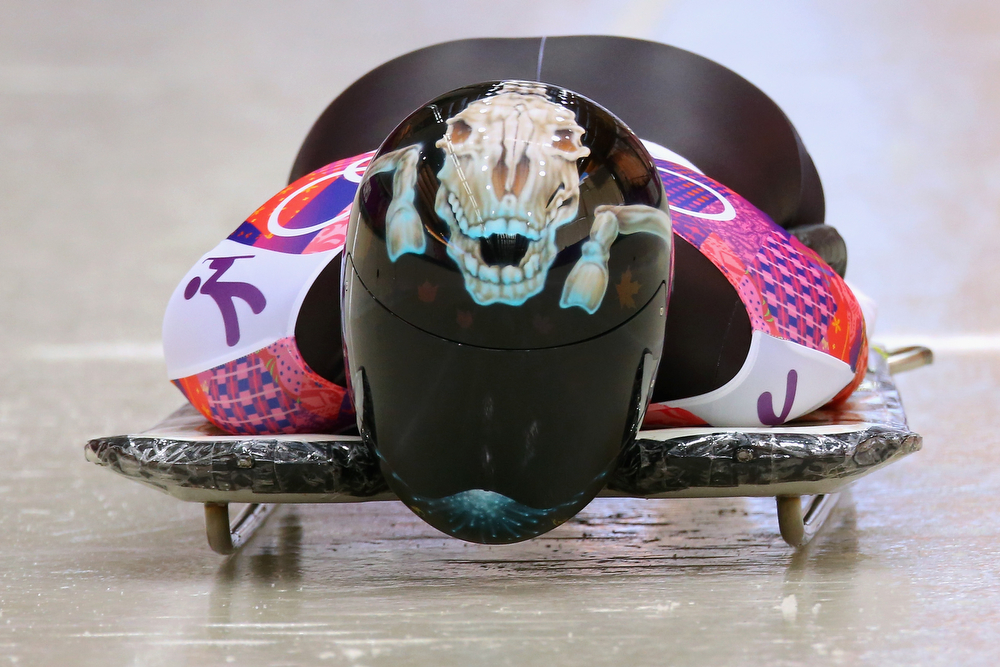 . Mellisa Hollingsworth of Canada makes a run during the Women\'s Skeleton heats on Day 6 of the Sochi 2014 Winter Olympics at Sliding Center Sanki on February 13, 2014 in Sochi, Russia.  (Photo by Doug Pensinger/Getty Images)