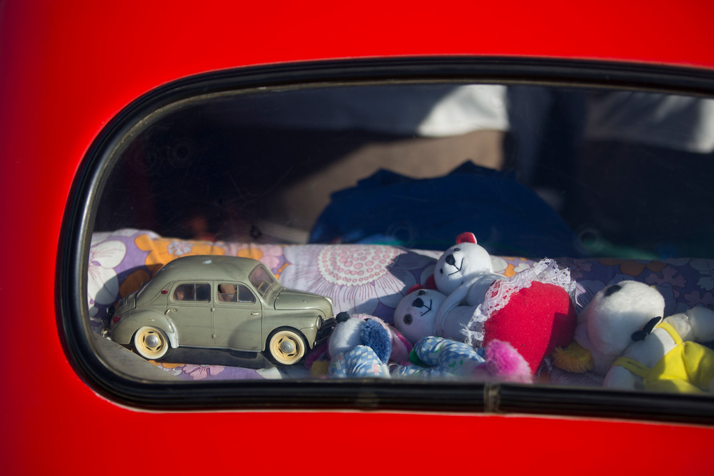 ". Toys placed in the back of an antique car during the 31st annual ""Five Club\"" car collectors\' meeting in Ramat Gan, Israel, Friday, Oct. 6, 2017. Each weekend, at Israeli gas stations and parking lots and parks, car collectors gather with their beauties _ and take a step back in time. (AP Photo/Oded Balilty)"