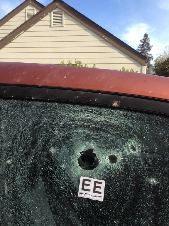 ". Bullet holes mar a car on Doyle Street in Santa Cruz, Calif., where shootings Tuesday <a href=""http://www.santacruzsentinel.com/localnews/ci_22674808/breaking-2-officers-1-suspect-shot-santa-cruz\"">claimed the lives of two police officers and a suspect</a>. (Shmuel Thaler/Sentinel)"