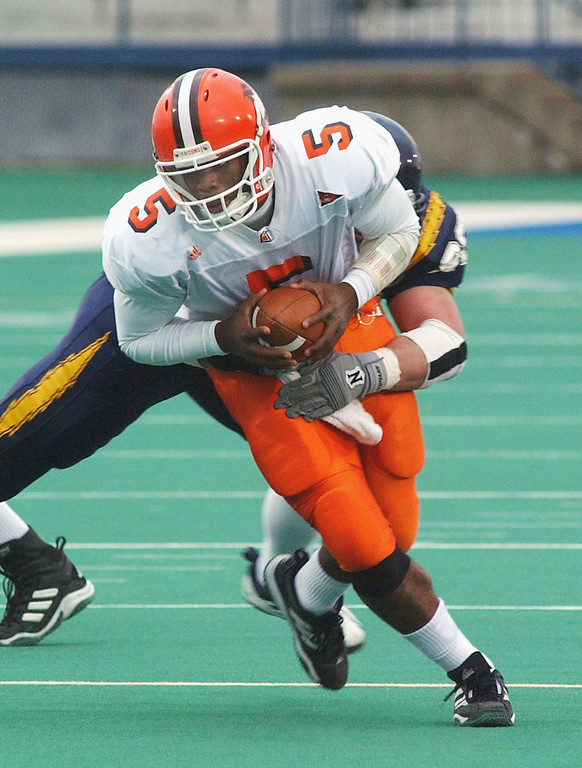 . Josh Harris, Bowling Green: Before Alex Smith, Tim Tebow and J.T. Barrett, Urban Meyer helped turn Harris in the Mid-American Conference star. Meyer went 17-6 in 2001-02 at Bowling Green and Harris took over as the starter as a sophomore that first season. After Meyer left for Utah, Harris really took off in 2003, with 3,813 yards passing, 830 yards rushing and 40 total touchdowns.  Pro career: Harris was drafted in the sixth round by Baltimore in 2004 and knocked around the NFL and CFL for three seasons. (Associated Press file)