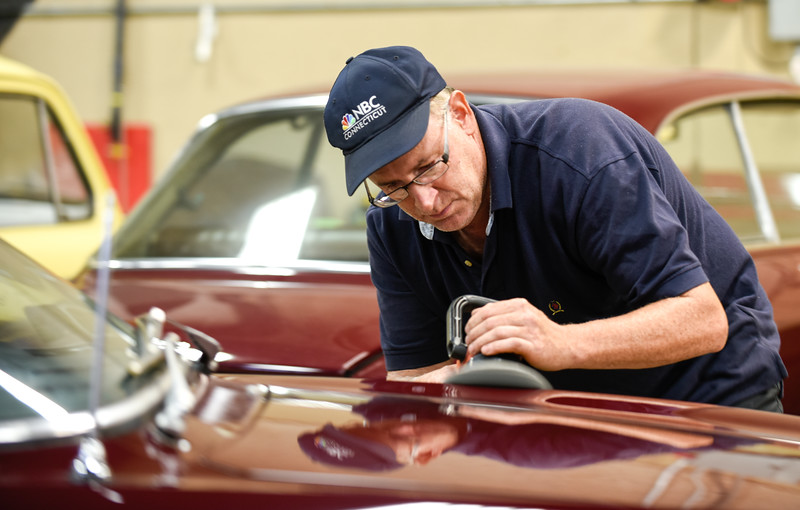 09/28/18  Wesley Bunnell   Staff  Brian Skibo of Skibo Services details a 1970 Alfa Romeo GT Veloce as his reflection can be seen in the hood.