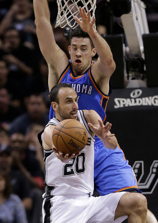 . San Antonio Spurs\' Manu Ginobili (20), of Argentina drives around Oklahoma City Thunder\'s Nick Collison during the second half of Game 1 of a Western Conference finals NBA basketball playoff series, Monday, May 19, 2014, in San Antonio. (AP Photo/Eric Gay)