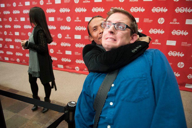 """. Actor Yayan Ruhian pretends to choke reporter Michael Dalton at the premiere of the film \""""The Raid 2\"""" during the 2014 Sundance Film Festival, on Tuesday, Jan. 21, 2014, in Park City, Utah. (Photo by Arthur Mola/Invision/AP)"""