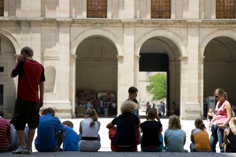 Visitors taking a break at Kings' square, El Escorial, Spain