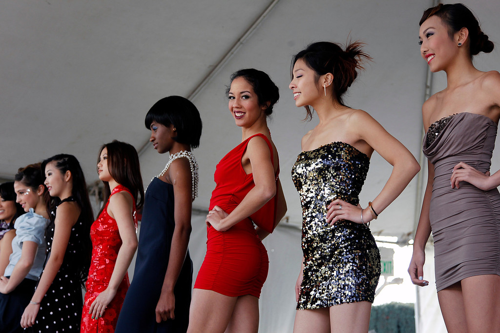 . Models model fashions from G.G. Connection, Rav Collections and Constance at the Tet festival hosted by the Coalition of Nationalist Vietnamese Organizations of Northern California (CONVONCA) at the Santa Clara County Fairgrounds in San Jose, Calif. on Saturday, February 2, 2013.   (LiPo Ching/Staff)
