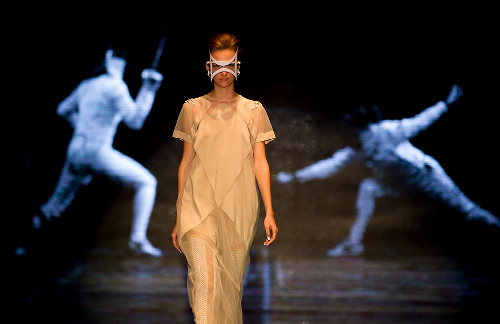 Description of . A model wears a creation by Israeli designer Yosef during a show at the Tel Aviv fashion week in Tel Aviv, Israel,Tuesday, Dec. 18, 2012. (AP Photo/Ariel Schalit)