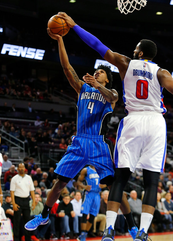 . Detroit Pistons center Andre Drummond (0) blocks an Orlando Magic guard Elfrid Payton (4) shot in the first half of an NBA basketball game in Auburn Hills, Mich., Wednesday, Jan. 21, 2015. (AP Photo/Paul Sancya)