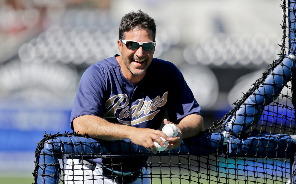 . San Diego Padres batting coach Phil Plantier relaxes between hitters while throwing early batting practice at Petco Park before the Padres\' baseball game against the Los Angeles Dodgers in San Diego, Wednesday, April 10, 2013. (AP Photo/Lenny Ignelzi)