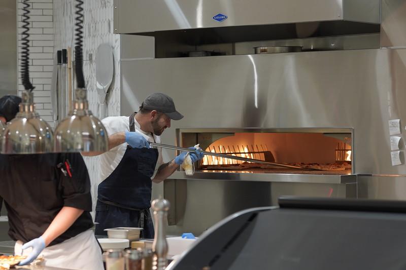 Chef Matt at the pizza oven.jpg