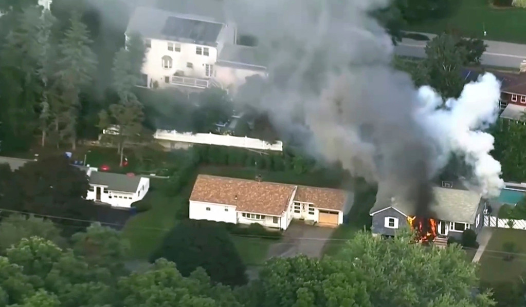 . In this image take from video provided by WCVB in Boston, flames rise from a house in Lawrence, Mass, a suburb of Boston, Thursday, Sept. 13, 2018. Emergency crews are responding to what they believe is a series of gas explosions that have damaged homes across three communities north of Boston. (WCVB via AP)