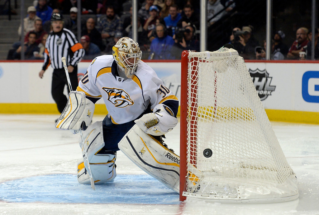 . Nashville Predators goalie Carter Hutton (30) looks to cover up the bouncing puck as it hits off the back of the net during the third period agains the Colorado Avalanche November 6, 2013 at Pepsi Center. The Nashville Predators defeated the Colorado Avalanche 6-4.  (Photo by John Leyba/The Denver Post)