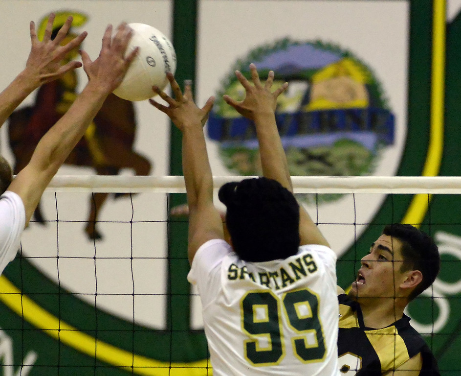 . in the first game of a prep volleyball match at Damien High School in La Verne, Calif., on Wednesday, May 20, 2015. Damien won 25-17, 25-19, 29-27. (Photo by Keith Birmingham/ Pasadena Star-News)